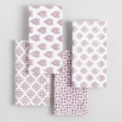 Our ultra-chic napkins featuring a patchwork of four different purple patterns over a white background can be folded in various ways to instantly change up the look of your place settings.