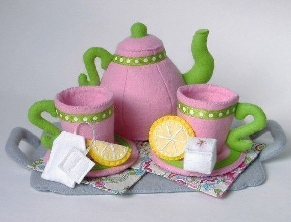 Felt Food Pattern    *** Pattern and instructions only ***    Tea time! Everything you need for your next fabulous tea party is included in this whimsical pattern. A lovely teapot, teacups & saucers, tea bag, sugar cubes, lemon slices, napkins- and even a fun serving tray, to serve your guests.