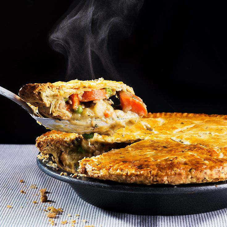A flaky, buttery crust studded with fresh herbs and garlic sits on top of creamy chicken and vegetables for the perfect potpie.