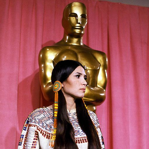 SACHEEN-LITTLEFEATHER accepted the best actor award for Marlon Brando in the Godfather. Brando had boycotted the Oscar's due to the treatment of native Americans by Hollywood.