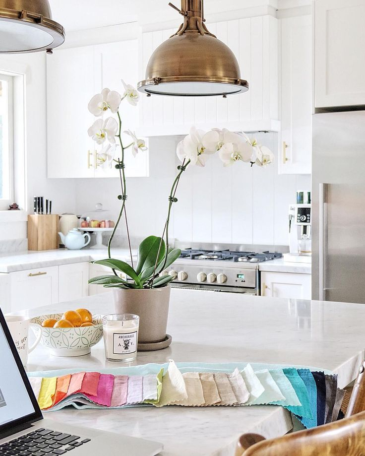 Cottonwood Interiors White Kitchen With Carrara Marble And