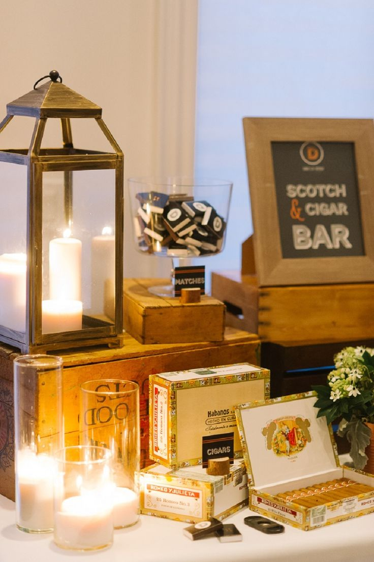 Cigar bar. A vintage oak table, vintage match boxes, crystal decanters, candle lanterns and old cigar boxes is the perfect way to create a cigar bar.