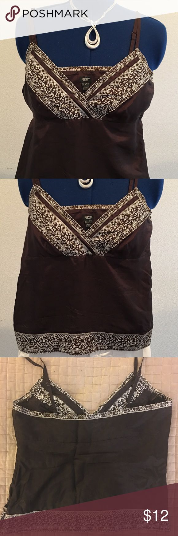 """ESPRIT Brown and White Embroidered Tank Size L/XL Hey Fashionistas! This adorable tank has your name written all over it!  Runs a bit small so I'd say it fits more like a Lg than XL, especially if you're busty.  Adjustable spaghetti straps.  Side zipper for a perfect fit.  100% silk. Hand wash or dry clean. 17"""" from base of strap to hem. 5"""" from base of strap to vneck. 16"""" across under busy laying flat.  Necklace not included.  Check back soon as I'll be posting a TON of stuff over the next…"""