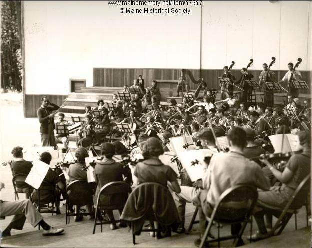 The orchestra at Eastern Music Camp on Lake Messalonskee rehearsing in the Bowl, the outdoor performance facility.   The camp operated from 1931-1934. And now operates as New England Music Camp, the best place on earth.