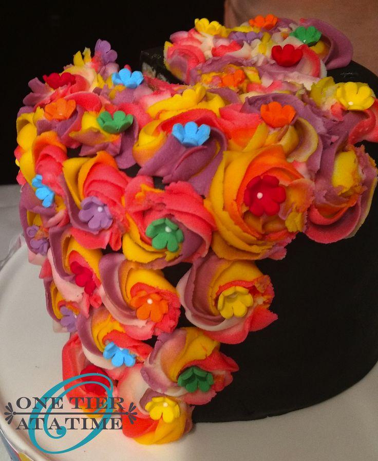 Black unicorn cake with rainbow icing