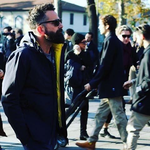 Snap shot of @guillermoarieu at #Pitti89 by @guaizine. Wearing @swimsofficial Seattle Utility Jacket in navy with Portland Gilet in yellow. Wax Jacket @barbour x White Mountaineering Japanese Tempest Camo print. #swims #pittiuomo #barbour #streetstyle