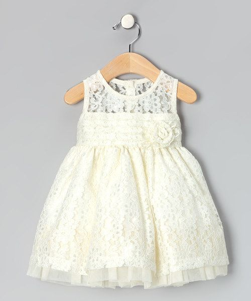 I purchased this for my niece's baptism for only $18.99, it was a beautiful lace dress! Everyone loved it As iridescent and intriguing as a pearl, this dress has lace that glitters and a back that buttons. A tie around the waist complements the full skirt. 100% polyesterMachine wash; tumble dryImported