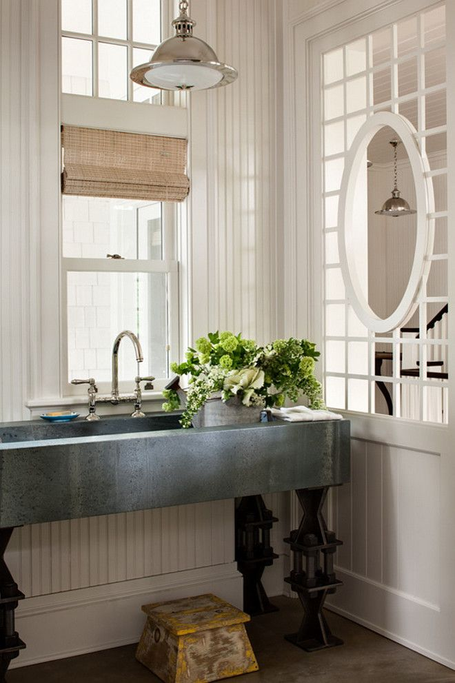 Laundry room with zinc basin sink and bridge faucet. Perfect sink for mudroom.