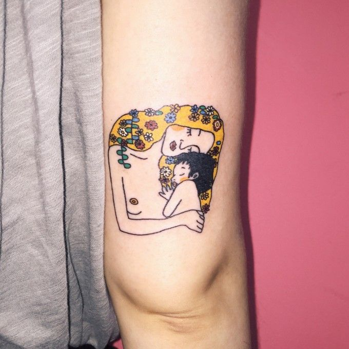 Lovely mother and child depiction in color! Awesome tattoo.