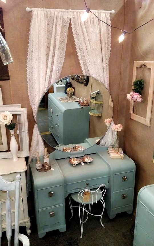 art deco waterfall vanity painted in duck egg blue with lace curtains behind- vintage glam at its best!