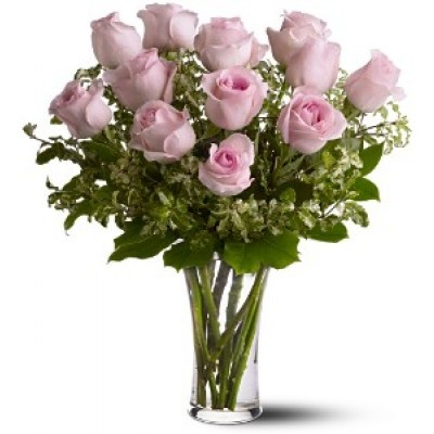 Pretty, pink and perfect. There's nothing like long-stemmed pink roses to show your affection. A dozen pink roses with variegated pittosporum and salal in a beautiful glass vase.