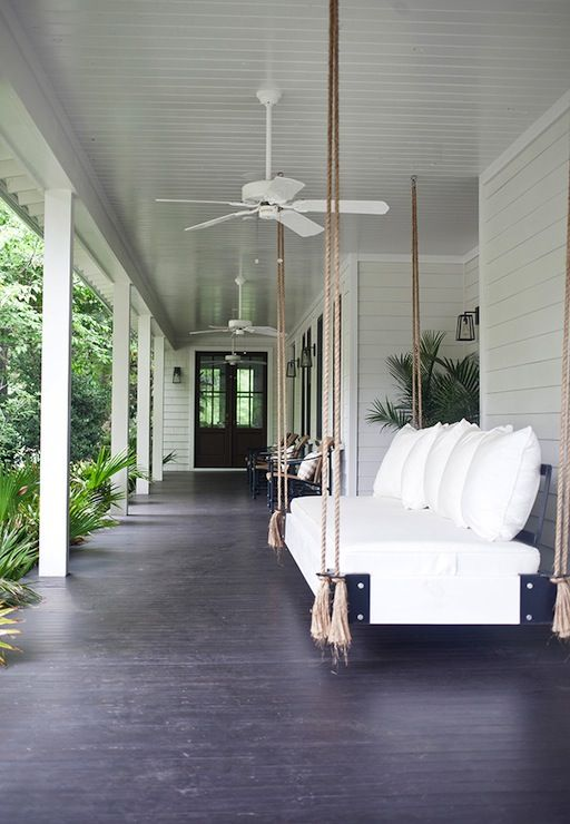 porch design w/dark stained wood floors & white beadboard ceiling | swinging sofa w/jute rope