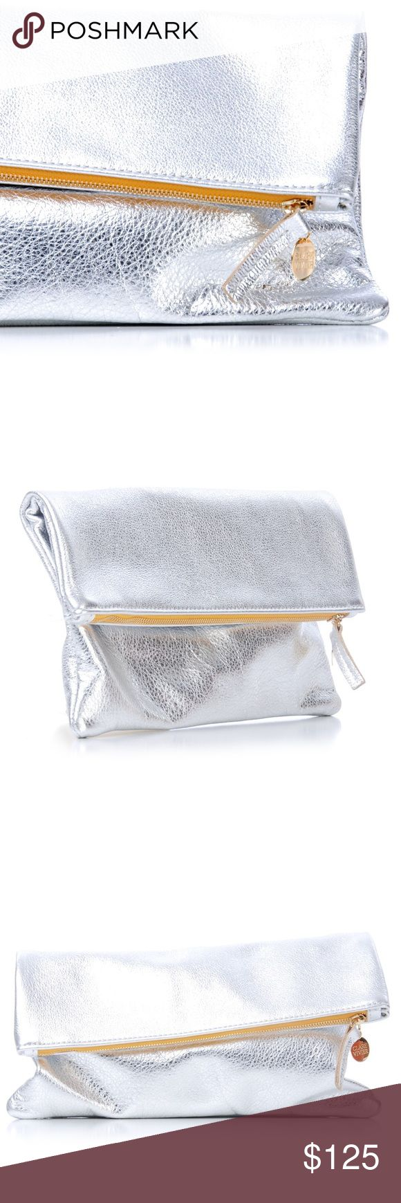 "CLARE VIVIER Silver Foldover Clutch NWT CLARE VIVIER Silver Foldover Clutch NWT -- comes with dustbag and in box, never worn, gorgeous and versatile. Zip top closure with logo pull charm, foldover design.  Approx 11.5"" x 11.5"" Clare Vivier Bags Clutches & Wristlets"