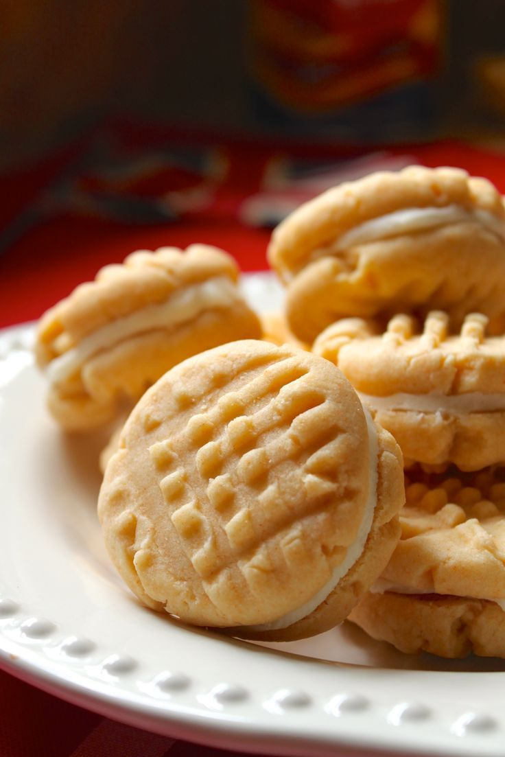 Homemade Custard Creams -- so deliciously crisp, with yummy buttercream in the middle! http://christinascucina.com/2015/05/how-to-woo-a-brit-bake-them-homemade-custard-creams.html