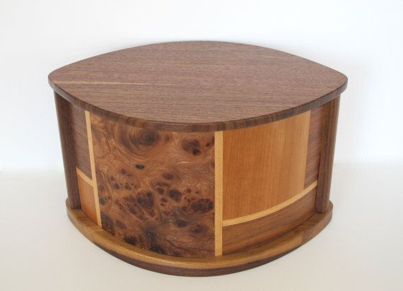 Simple and elegant wooden urn made of black walnut and decorated with inlay