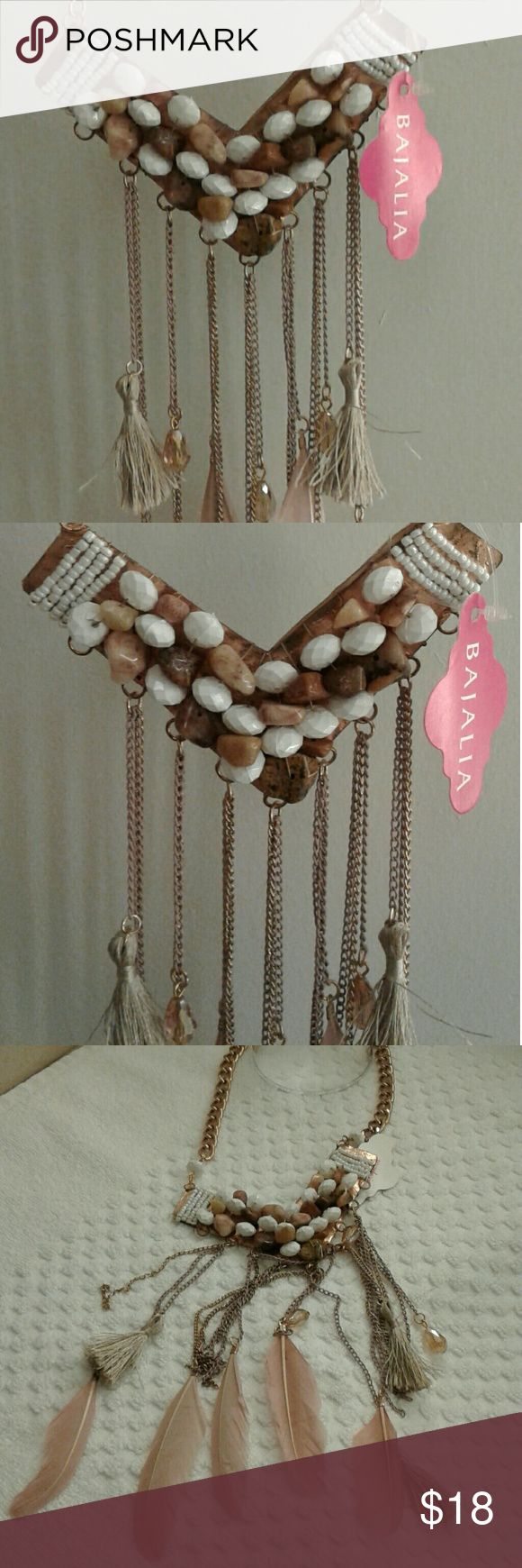 "Lovely feathers tassels and beads necklace NWT NWT gold, blush and cream colored feathers, tassels and beads decorate this lovely  necklace.  Measures 8 1/2"" lowest to 15"" to longest. Perfect with any outfit. Jewelry Necklaces"