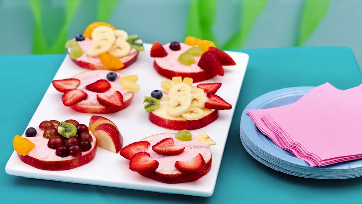 Under the Sea Birthday Party | Little Fish Fruit Sandwiches: So adorable and healthy too! When the kids need something to chow on, present a tray of these fish-shaped sandwiches made out of apple slices topped with cream cheese, strawberries, grapes, oranges and blueberries!