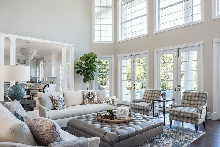 Transitional Living Room In A Two Story Home Featuring A Large Gray Leather Tufted Living Room Leather Transitional Decor Living Room Transitional Living Rooms #sofa #for #large #living #room