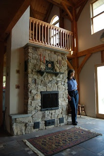 A masonry heater with bake oven. I've read that these are common in Scandinavia, parts of northern Europe and Russia. This one happens to be inside a net-zero, off-grid timber frame home in Pennsylvania that utilizes both passive and active solar technology. This image from the homeowner's blog; read more at the mason's website: http://fireworksmasonry.com/archives/41