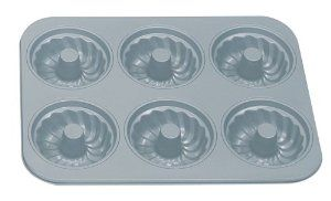 Fox Run Non-Stick Fluted Cake/Muffin Pan with Center Tube by Fox Run. $22.78. Non-Stick material. Six cup fluted muffin/individual cake pan with center tube; each cup holds-3/4 cup. 5 year warranty. Pan dimension-13-3/4 Inch by 10-1/2 Inch. The Fox Run Kitchen's Preferred non-stick was designed specifically for Fox Run.  This collection features our exclusive premium non-stick coating, which provides quick, easy release of baked goods.  These pieces are made o...