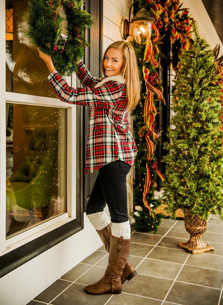 Christmas Look by The Red Dress Boutique. I love the decorations! Outfit is cute to but man I'd love to hang a huge wreath on my door this year.