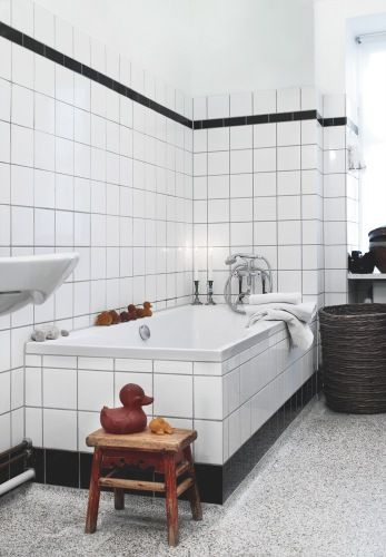 White bathroom tile with black grout, a great way to bring in black accents without being too overpowering