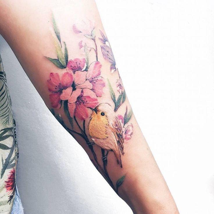 Cherry blossom with bird tattoo