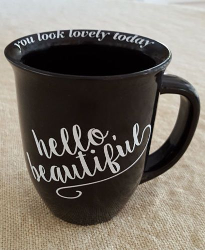 "Large ""HELLO, BEAUTIFUL"" coffee mug. Around the inside lip of the mug, ""you look lovely today""."