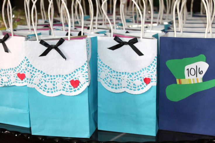 Alice bags to hold cookie favors... especially since she puts some in her pockets in the movie... perfect!!