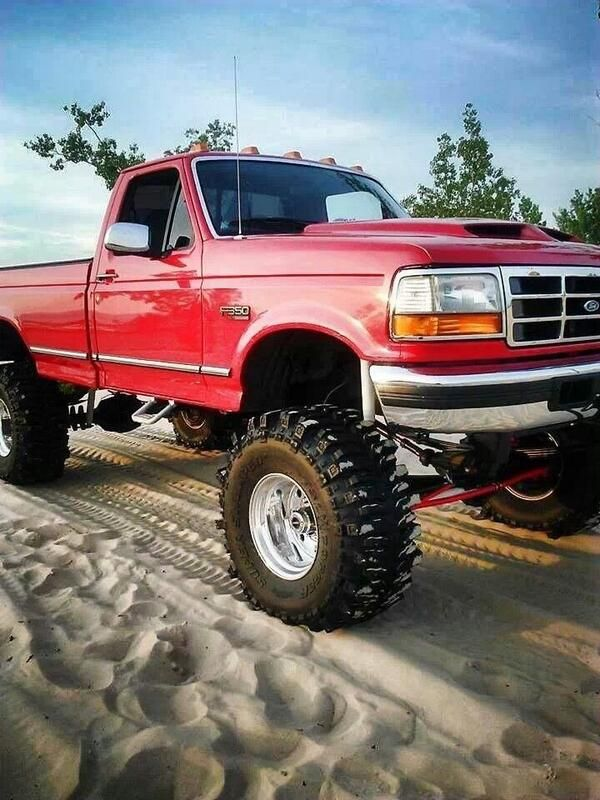 Lifted Red Ford Powerstroke F-350 Truck   www.dieseltees.com #powerstroke #dieseltruck #liftedtruck