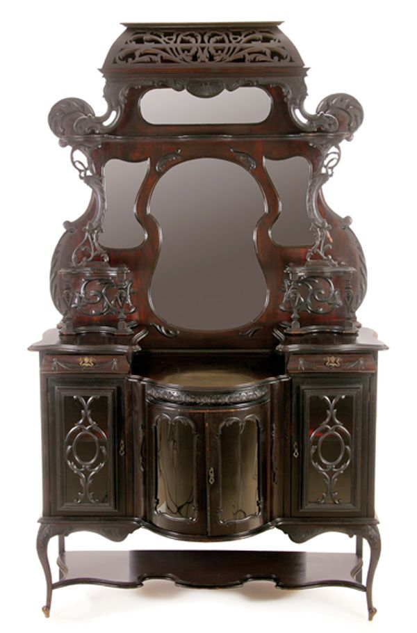 A Victorian Carved Mahogany Sideboard, 19th Century.