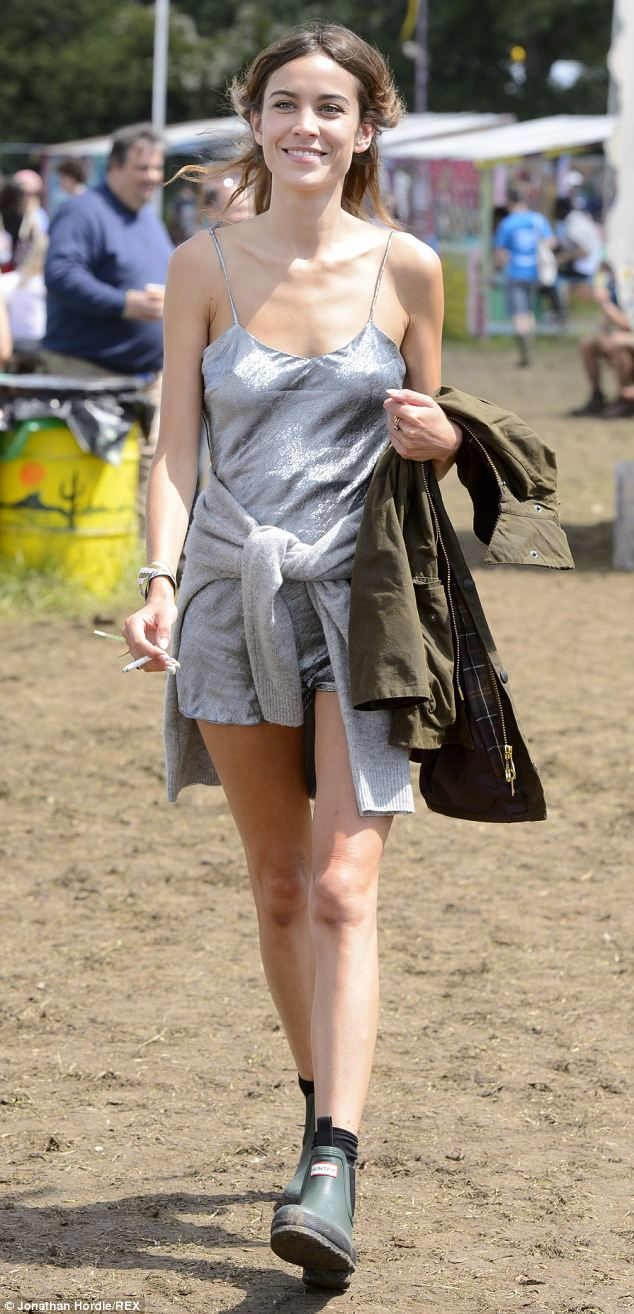 She's beaming: Alexa Chung wows in a silver playsuit as she strolls at Glastonbury...