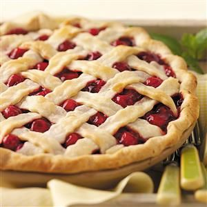 Fresh Cherry Pie Recipe -This ruby-red treat is just sweet enough, with a hint of almond flavor and a good level of cinnamon. The cherries peeking out of the lattice crust makes it so pretty, too. —Josie Bochek, Sturgeon Bay, Wisconsin