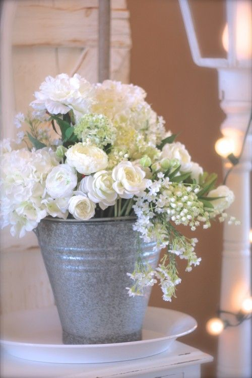 Pretty flowers in a galvanized bucket floral for Large galvanized buckets for flowers