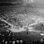 The crowd at Comiskey Park on Disco Demolition night was estimated at 50,000. After the first game of a scheduled doubleheader against the Detroit Tigers, a pile of disco records was blown up, and fans stormed the field. The second game was called off when umpires ruled the field unfit for play. | Photo Credit: AP Photo/Fred Jewell