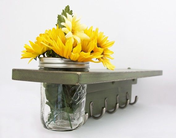 Shelf with hooks and jar for flowers.