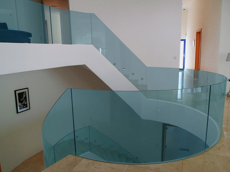 Curved Glass Balustrade on stair supplied and installed by Camel Group