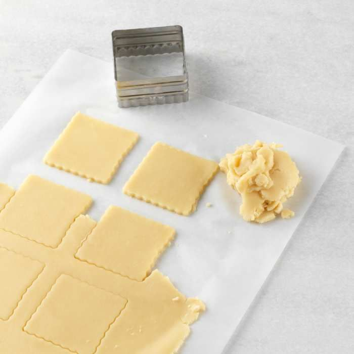 """Nonstick, precut, reusable parchment is your best baking assistant. Line your baking sheets or pans with a sheet and forget about scrubbing afterward. Simply slide cookies off after baking, and use over and over again.      Heavy duty, 100-count, soy-free, vegetable-based silicone coated; approximately 140-sq. ft.    Each sheet measures 16½"""" x 12¼"""", just the right size for most cookie sheets; it nestles perfectly into our half sheet pans."""