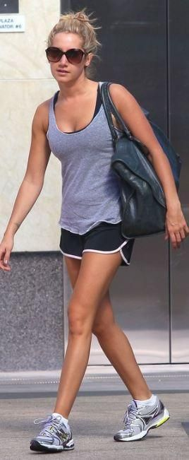 Who made Ashley Tisdale's gray tank top, shorts, sunglasses, leather handbag and sneakers that she wore in Hollywood on September 29, 2011? Shirt and shorts – American Apparel  Purse – Balenciaga  Shoes – New Balance  Sunglasses – Chanel