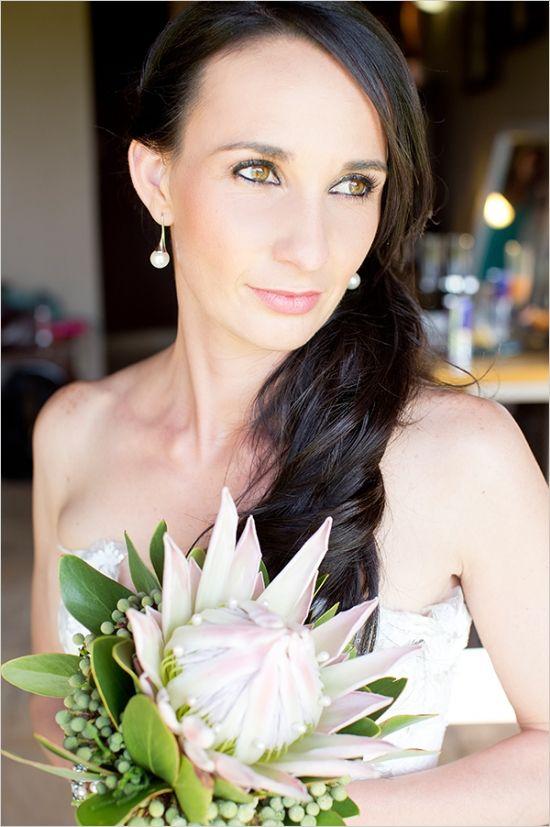 single stem protea wedding bouquet #bouquet #bride #weddingchicks http://www.weddingchicks.com/2014/02/27/south-africa-farm-wedding/
