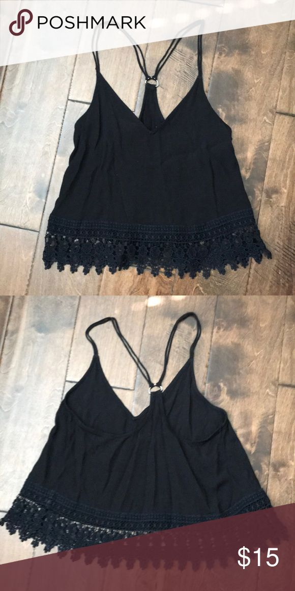Urban Outfitters black going out top/tank Urban Outfitters Black tank with crochet detailing on bottom. Not a cropped top, very cute with jeans and heels Size small but could fit medium Urban Outfitters Tops Tank Tops