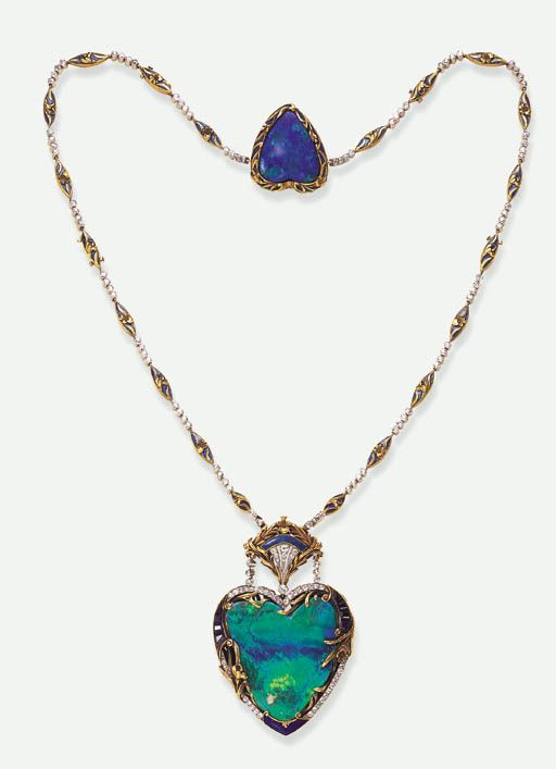 A SUPERB BELLE EPOQUE OPAL PENDANT NECKLACE   Centering upon a heart-shaped opal pendant, within a calibré-cut sapphire, old European-cut diamond & blue enamelled frame, enhanced by sculpted scrolling gold iris motifs, suspended by twin diamond collet lines from a similarly-set fan-shaped surmount, to the backchain of alternating diamond collets & navette-shaped blue enamelled foliate motif links, joined to a smaller heart-shaped opal plaque within a sculpted gold iris motif frame, circa…