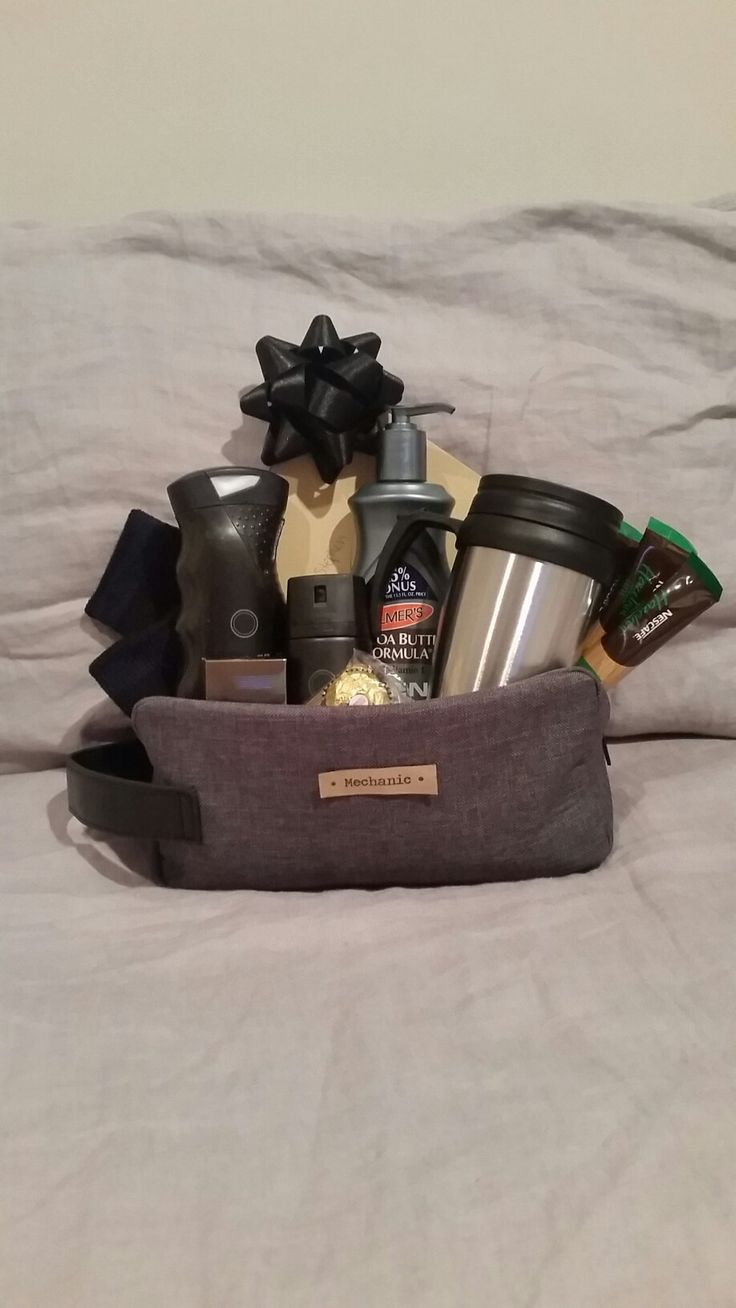 K8iekates Original Pin - Mens Care Gift Basket for Mechanic Apprenticeship or for any Tradesmen. Made from toilet bag, Socks, body wash, body spray, Cologne, body moisturizer, Ferrero Rochers, Thermas and instant coffee sticks. Filled Thermas with sweets for an extra treat! Card snuck in behind. Made tag from simply printing onto brown paper ( for decoration only )