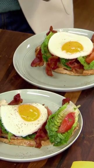 Geoffrey tops off an open-face BLT sandwich with a perfectly fried egg.