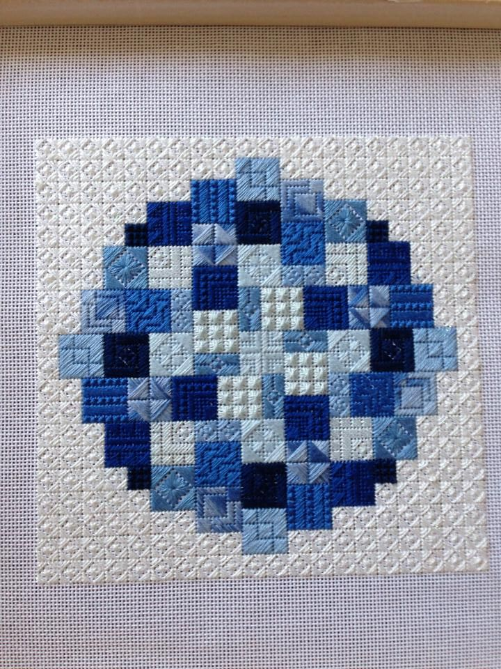 circular needlepoint in blue, stitch sampler