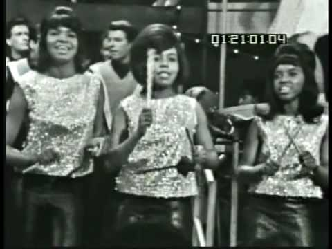 """Iko Iko by Dixie Cups, Rare Video-1965, a later 1982 version by UK's Girl Group-Belle Stars been used in many soundtracks, inc 88's Rain Man & 09's The Hangover (Entering Casino)...My grandma and your grandma, Sitting by the fire, My grandma says to your grandma """"I'm gonna set your flag on fire""""…Talkin' 'bout, Hey now, Hey now, Iko iko an nay, Jockomo feena ah na nay, Jockomo feena nay…"""