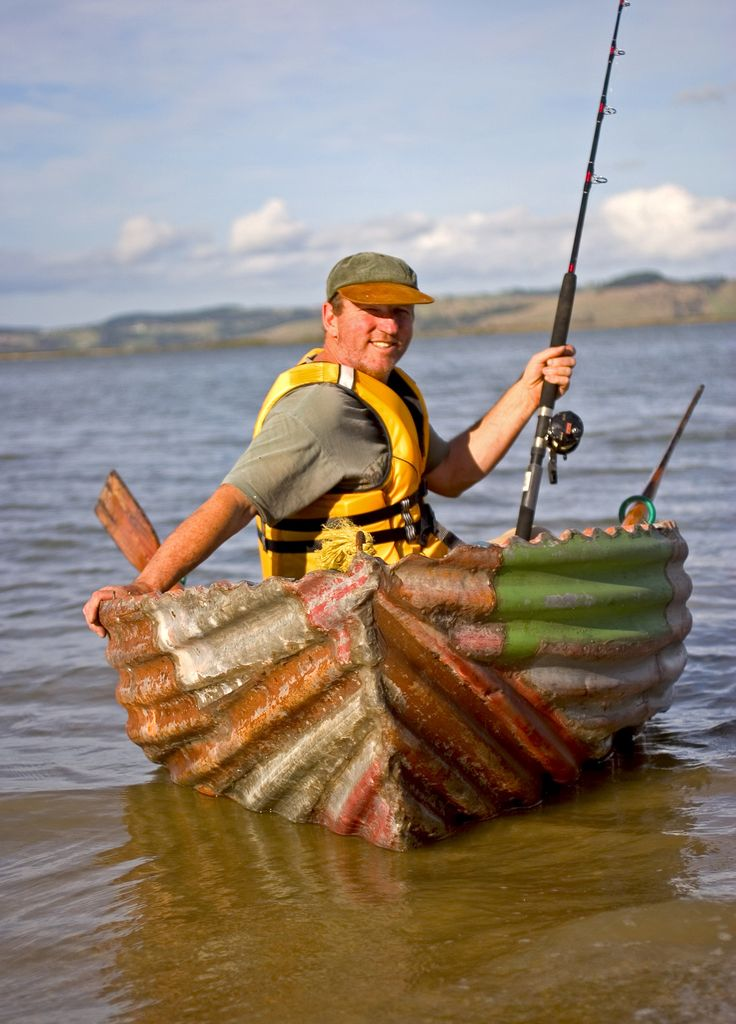 Artist Jeff Thomson in his corrugated steel dinghy. Steel supplied by New Zealand Steel.