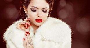 Fashion woman with red lips and nails in fur coat. Luxury and  Jewelry