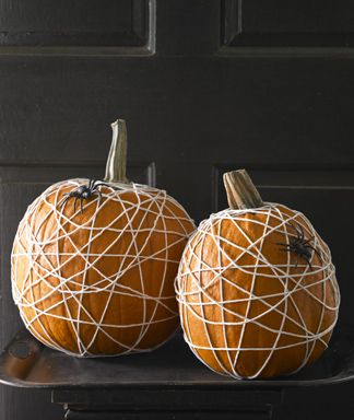 Super simple pumpkins wrapped in kitchen twine with added plastic spiders!