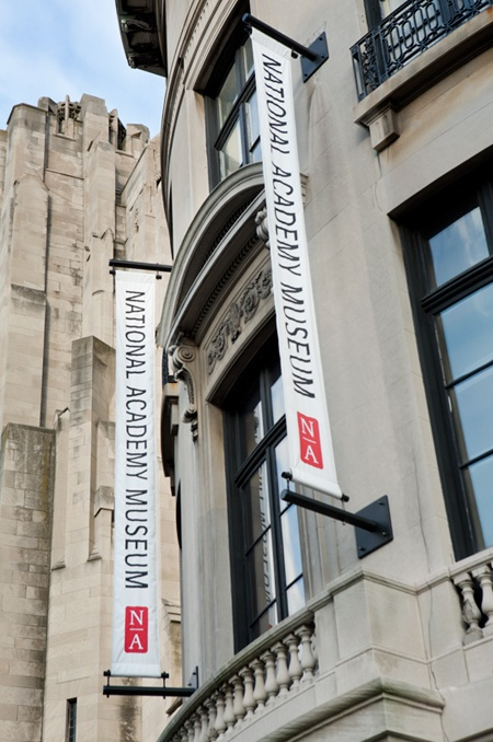 Pentagram: Banners on the façade give the Academy a more prominent presence on Museum Mile.